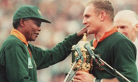 Francois Pienaar receiving the Rugby World Cup from Nelson Mandela. ((Source)
