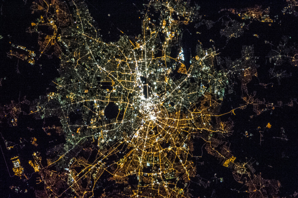 Photograph taken by astronaut Chris Hadfield from the International Space Station. The angle is skewed, but you can clearly see the bright white street lamps of Western Berlin towards the top, and the dimmer, yellow lights in Eastern Berlin towards the bottom. This is caused by the lower-quality lighting used in the East - in the West, street lamps were updated, indicating a higher level of investment in infrastructure. (Source)